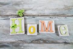 Pisać '' domowy '' na drewnie Fotografia Royalty Free