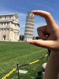 Pisa between fingers Stock Image