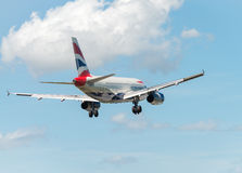 PISA, ITALY - AUG 25, 2015: British Airways airplane lands in Pi Royalty Free Stock Photography