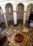 PISA, ITALY - CIRCA FEBRUARY 2018: The interior of the Baptistery at the Square of Miracles stock images