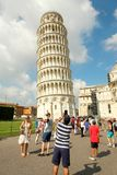 Tourists taking pictures of the Leaning Tower of Pisa Royalty Free Stock Photos