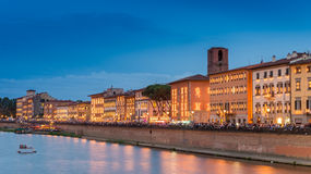 Pisa, Italy. Lungarno Galilei at dusk during Luminara Stock Photo