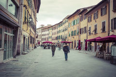 PISA, ITALY - MARCH 10, 2016: People visit Old Town of Pisa, Ita Royalty Free Stock Photography