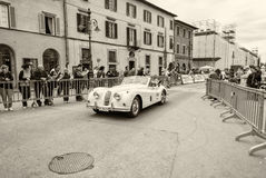 PISA, ITALY - MAY 16, 2015: Mille miglia competition car along c Royalty Free Stock Photo