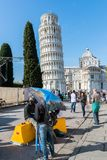Street Hawkers in Pisa, Tuscany, Italy. Pisa, Italy - October 28th, 2017: Street hawkers at the Leaning Tower of Pisa complex royalty free stock image