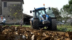 Tractor moves between the clods stock footage