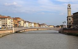Historical buildings along the river Arno in Pisa, Italy Stock Photography