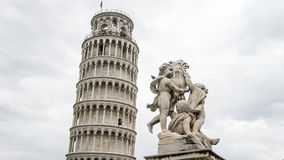 Pisa, Italy, - September 4, 2014: Pisa Leaning Tower with statue of angels, Pisa,  Italy Royalty Free Stock Images
