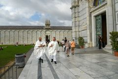Priests at Pisa Cathedral. Pisa. Italy. Pisa, Italy - September 23, 2018: Priests at Pisa Cathedra, or Duomo di Santa Maria Assunta stock images