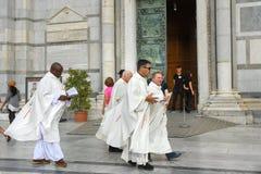 Priests at Pisa Cathedral. Pisa. Italy. Pisa, Italy - September 23, 2018: Priests at Pisa Cathedra, or Duomo di Santa Maria Assunta royalty free stock photos