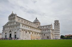 Tourists visit the Leaning Tower of Pisa Stock Photo