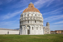 Pisa Leaning tower and Baptistery in Italy in summertime Royalty Free Stock Images
