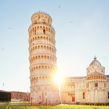 Pisa leaning tower and cathedral basilica at sunrise, Italy. Travel concept royalty free stock photo