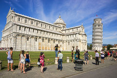 Pisa Leaning tower, Cathedral and tourists in Italy in summer Stock Photos