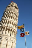 Pisa leaning tower with tourist signs. Pisa's leaning and dome royalty free stock image