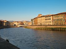 Pisa Lungarno. A view of the Arno River, buildings, bridge. Pisa, Italy Royalty Free Stock Photos