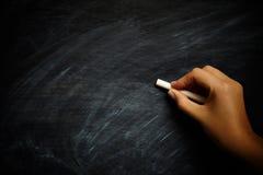 Pisać na blackboard Zdjęcie Royalty Free
