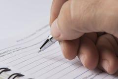 Pisać notatkach agenda Obraz Royalty Free