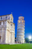 Pisa, Piazza del Duomo, with the Basilica leaning tower at dawn Royalty Free Stock Photography