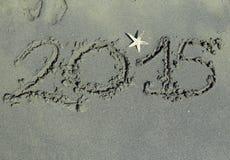 Pisać 2015 rok w piasku Zdjęcia Stock