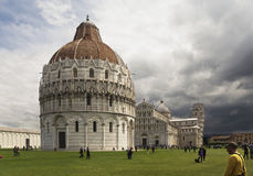 Pisa, the square of leaning tower. Miracles square, Pisa, Italy - Battistero (baptistery Royalty Free Stock Photo