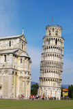 Pisa tower. View on falling Pisa tower and castle fragment. Pisa, Italy, EU Stock Photos