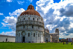 Pisa Tower. At the bottom of a large walled fortress it is situated one of the most famous towers in Europe. With an incredible inclination , challenges the Royalty Free Stock Image