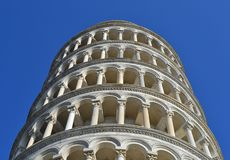 Pisa tower details. Details of the campanile (bell tower) in Piazza dei Miracoli . The construction  began in 1173 and took place in three stages over the course Royalty Free Stock Image