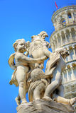 Pisa tower with sculpture in front of Royalty Free Stock Photo