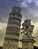 Pisa tower and statue. Pisa Tower at Tuscany, Italy (monocrome yellow blue) pisa's stock photo