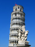 Pisa tower and statue. Pisa royalty free stock photography