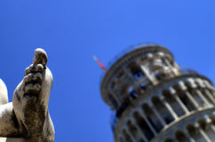 Pisa tower and statue Royalty Free Stock Photo