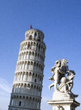 Pisa Tower - Torre di Pisa. Famous Pisa tower with cherubins statue, during a  sunny day Stock Photography