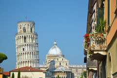 Pisa town with the leaning tower and the dome. Photo with details of the medieval town of Pisa (Italy) with the famous leaning tower in the background Royalty Free Stock Photography