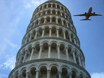 Pisa Travel. A metaphorical tourism image depicting an aeroplane flying past the leaning tower of Pisa, in Italy Stock Images