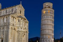 Nightscape of the Cathedral of Pisa and the legendary leaning tower royalty free stock photography