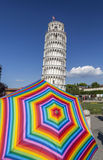 Pisa,Tuscany,Italy. Iconic italian building, tower, Torre pendente and colored umbrella Royalty Free Stock Images