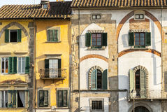 Pisa (Tuscany). Pisa (Tuscany, Italy) - Old houses with very different windows on the Arno river Stock Image