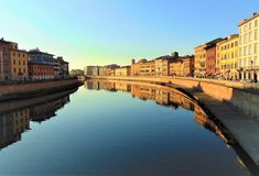 Pisa Tuscany Italy.View of the city from bridge on river Arno at sunset.Toned foto stock photo