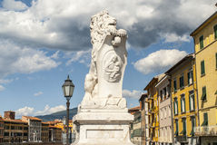 Pisa (Tuscany) - Statue of lion and colorful houses Stock Image