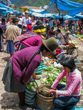 Pisac, Peru. Unidentified people at the market in Pisac. It is a Peruvian village in the Sacred Valley. The village is well known for its market every Sunday Royalty Free Stock Photo