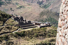 Pisac Ruins in Peru. Pisac, Peru - May 15: Tourists walking and enjoying the amazing views of the Pisac Ruins. May 15 2016, Pisac Peru Stock Photos