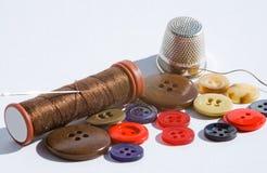 Pisadas y botones de costura Foto de archivo libre de regalías