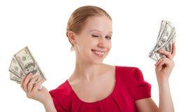 Piscadelas engraçadas da menina da beleza, preensões o dinheiro, foto de stock royalty free