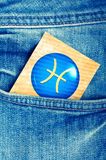 Pisces. Astrology card with zodiac sign of pisces in a blue jeans pocket stock photography