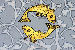 Pisces the fish zodiac sign. Ancient wall painting of a zodiac symbol of Pisces stock photo