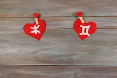 Pisces and twins. signs of the zodiac and heart. wooden backgrou. Nd. card. characters. unusual handwork stock image