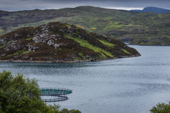 Pisciculture in Loch A Chairn Bhain, Scotland. Royalty Free Stock Photo