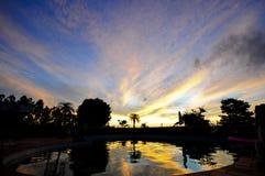 Piscina de la puesta del sol Fotografía de archivo libre de regalías