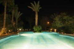 Piscina en la noche Imagen de archivo libre de regalías